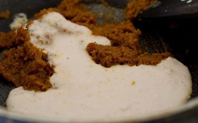 adding cashew paste to make punjabi dum aloo recipe