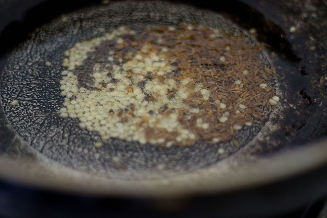 fry spices and urad dal in oil