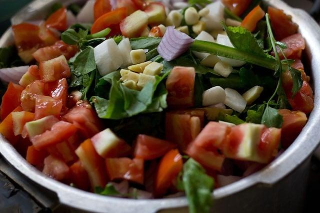 adding veggies for sarson ka saag