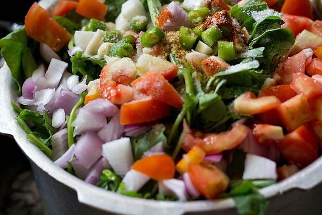 adding green chilies, red chili powder, asafoetida & salt