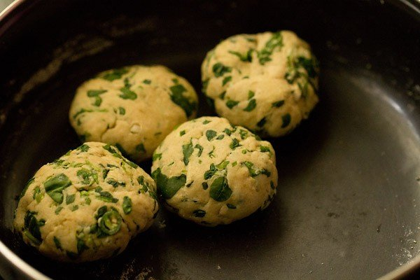 four medium-sized dough balls for methi paratha