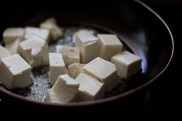 in a pan pan fry the silken tofu.