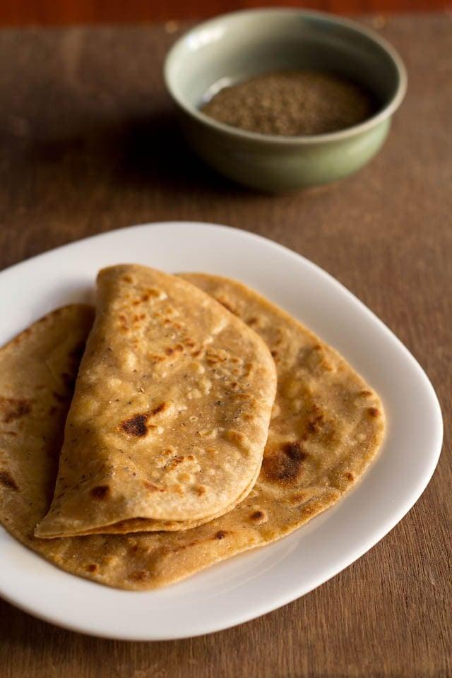 ajwain paratha served on a white plate