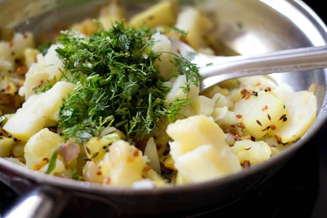 adding boiled and chopped potatoes