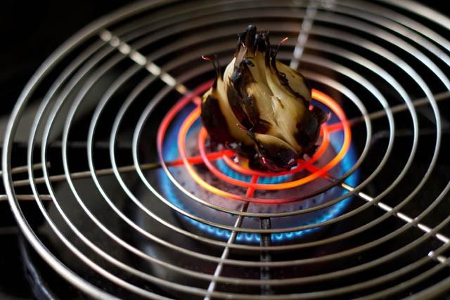 roasting the garlic bulb on fire
