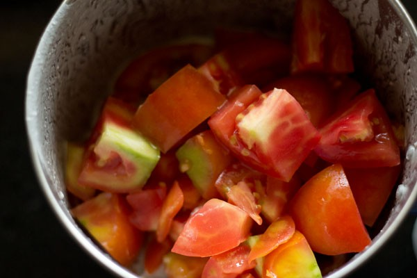 chopped tomatoes for tomato puree for paneer butter masala