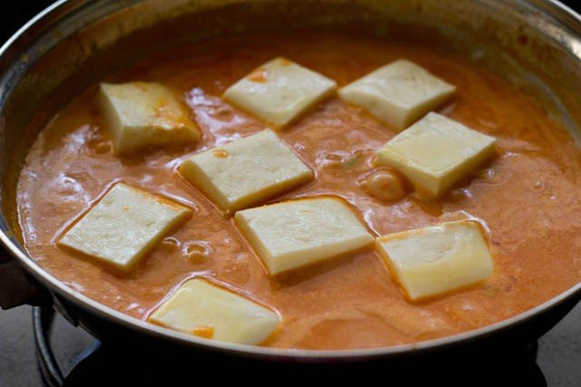 adding paneer cubes in paneer butter masala