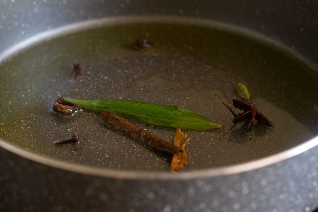 frying spices for palak biryani