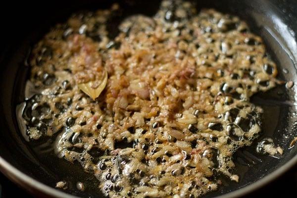 sauting onions - making palak paneer recipe