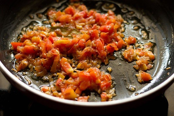 sauting tomatoes to make palak paneer recipe