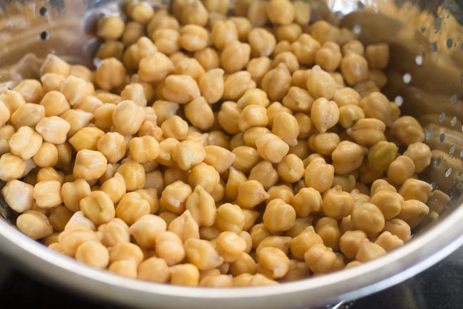 drained and soaked chickpeas in a colander