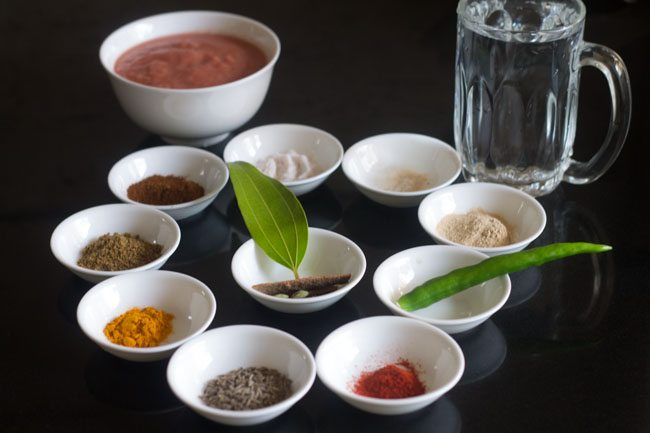 spices and other ingredients kept in individual white bowls.
