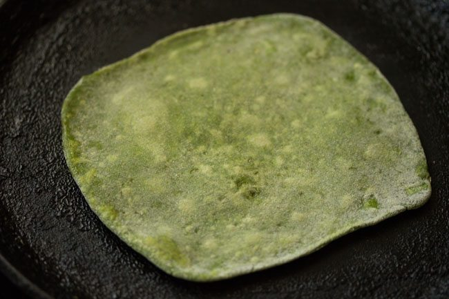 flip the 1/4 cooked palak paratha