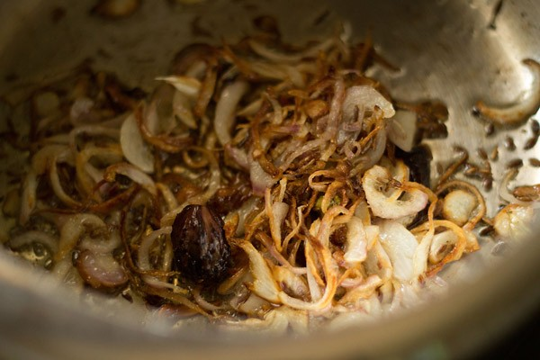 sauting onions to make vegetable pulao