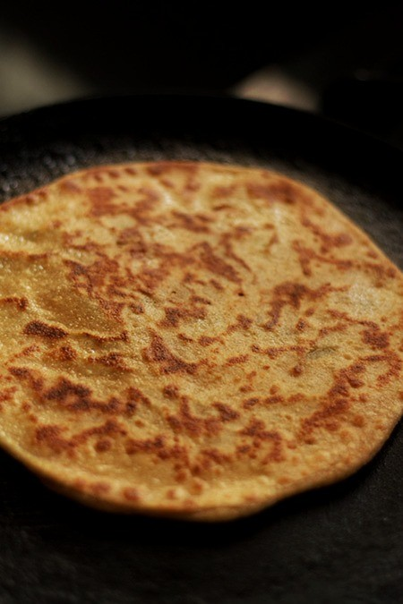 frying aloo paratha