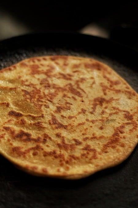 frying aloo paratha