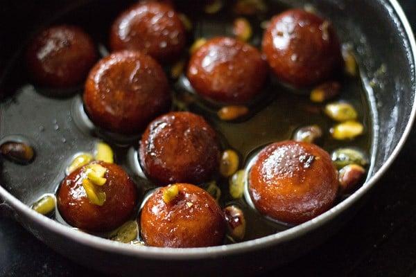 gulab jamun placed in sugar syrup