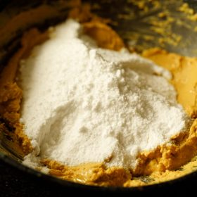 powdered sugar added to the roasted besan and ghee mixture
