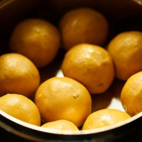 besan ke laddu placed in a steel container