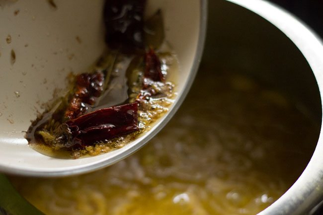 add tempering mixture to dal