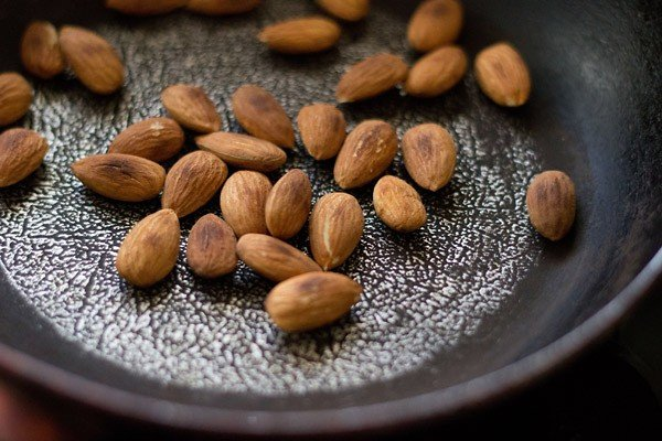 roast almonds for making dry fruits ladoo recipe