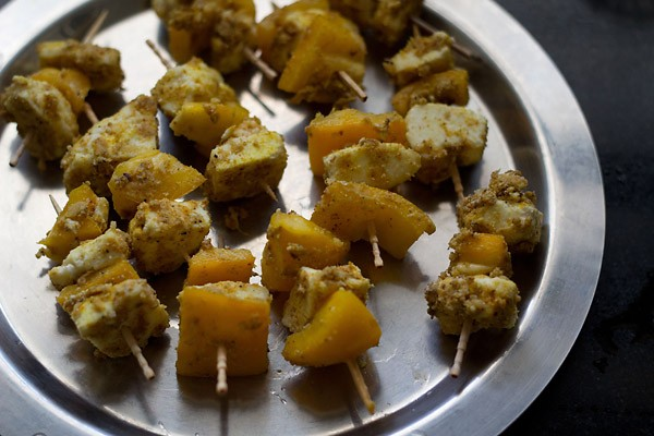 skewer the paneer pieces