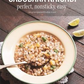 sabudana khichdi served in a green rimmed cream colored plate with a brass spoon