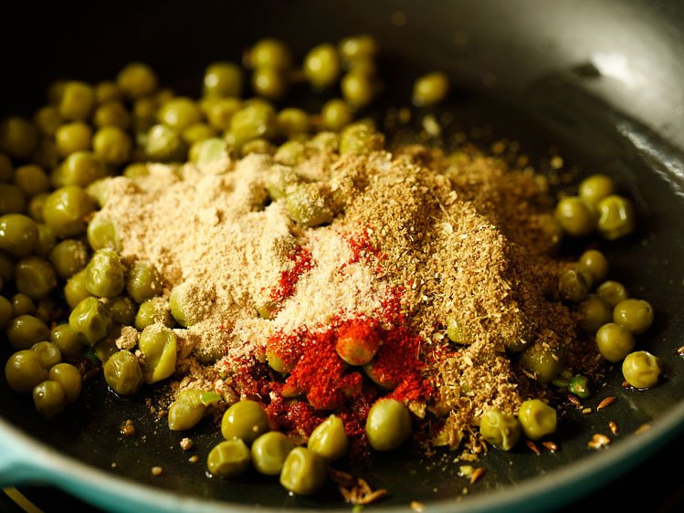 green peas, spice powders added in the pan