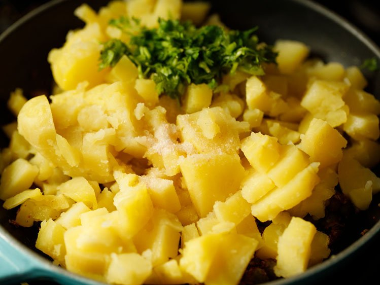 potatoes, salt and coriander leaves added
