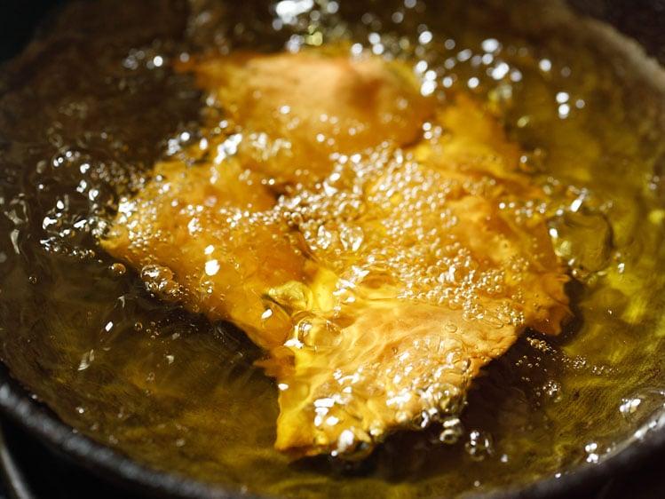 samosa turning crisp and golden in hot oil