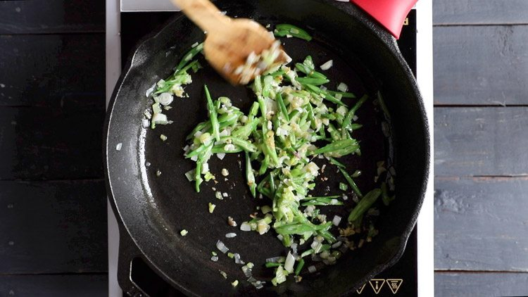 stir frying french beans for veg noodles recipe