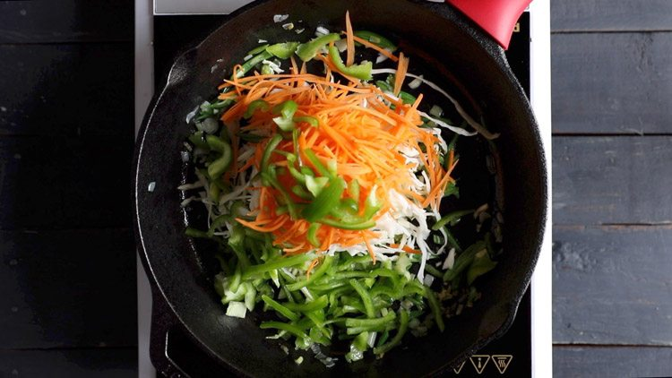 adding carrots, cabbage, capsicum for veg noodles recipe