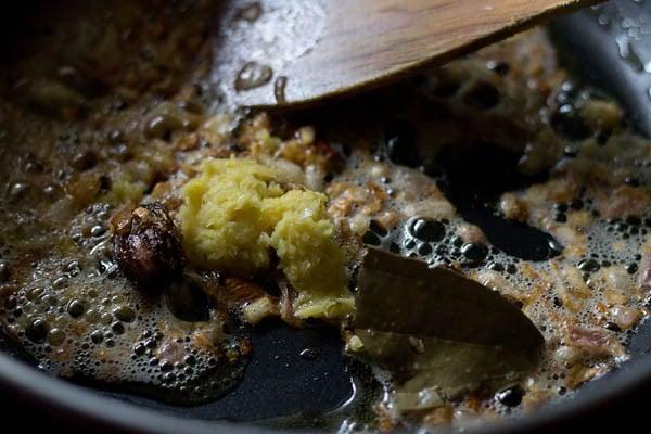 adding ginger paste to make aloo gobi recipe