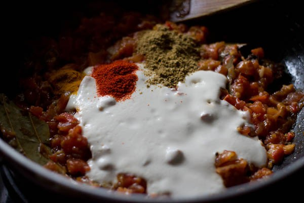 adding cream to make aloo gobi masala recipe