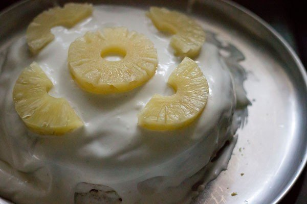 decorate cake with pineapple slices
