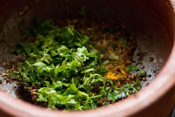 add spices - making pepper cumin rasam recipe