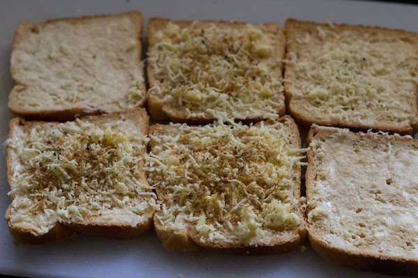 cheese topped on bread - making grilled cheese sandwich recipe