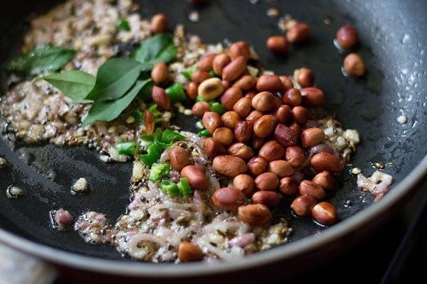 add peanuts - making onion potato poha recipe