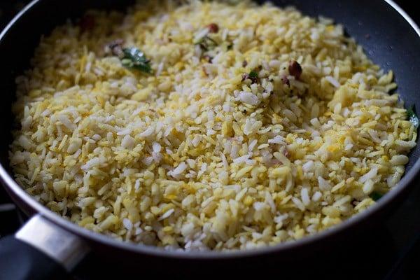 add potatoes - making onion potato poha recipe