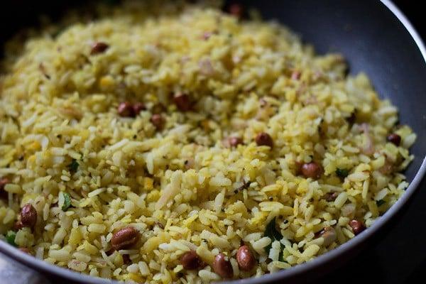 preparing kanda batata poha recipe
