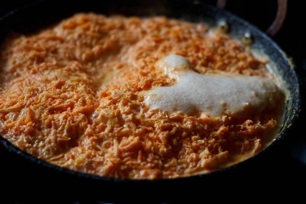 making gajar halwa on stove top with milk