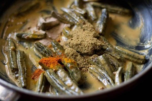 preparing besan bhindi