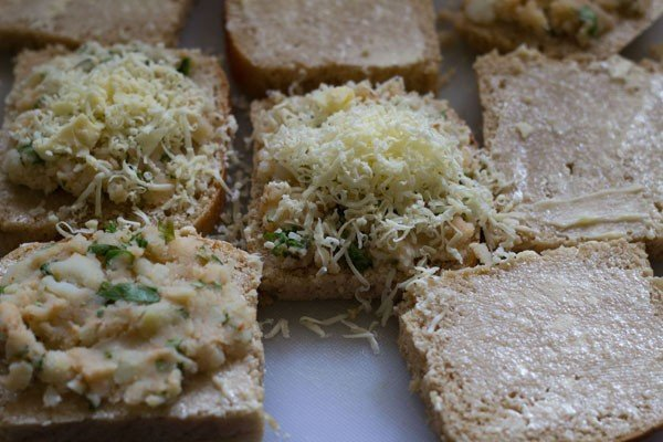 grated cheese on sandwich