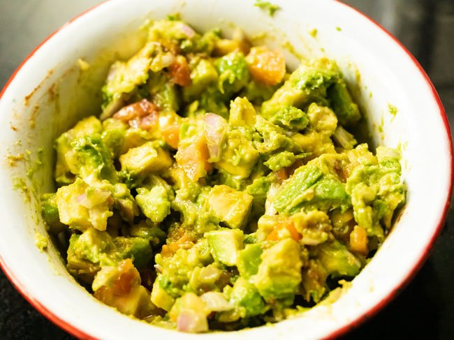 Toss and mix the avocado salad well