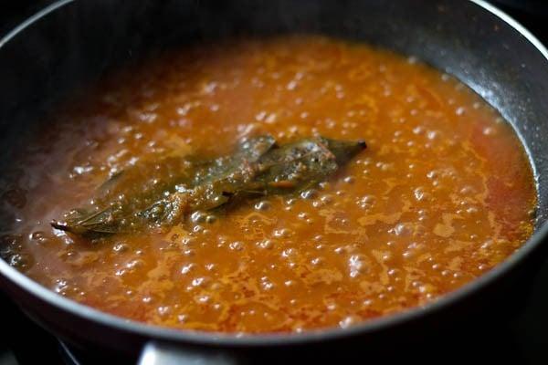 preparing paneer makhani recipe by reducing gravy prior to adding cream