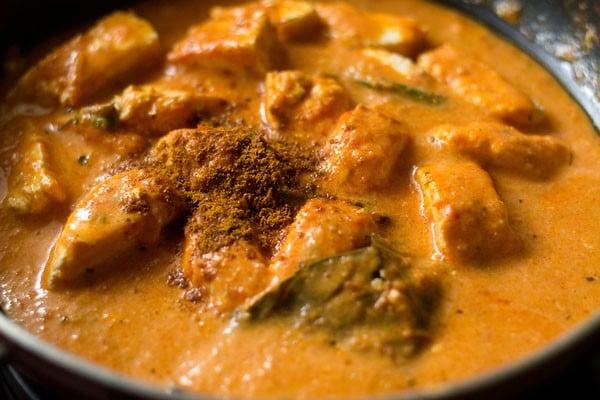 garam masala added to paneer makhani in pan