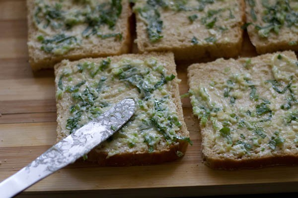 apply cheese on toast - making cheese garlic toast recipe