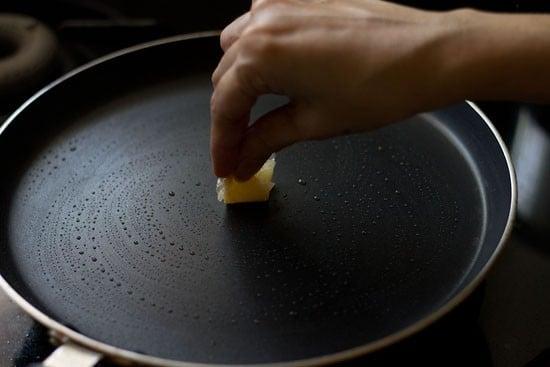 heat tava and apply oil on it
