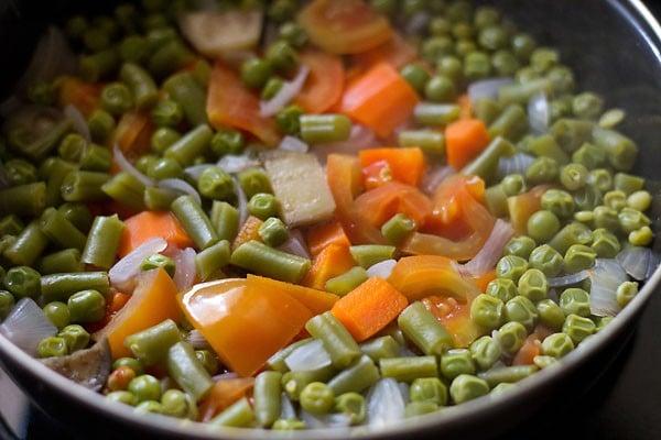 cooking veggies for making bisi bele bath recipe