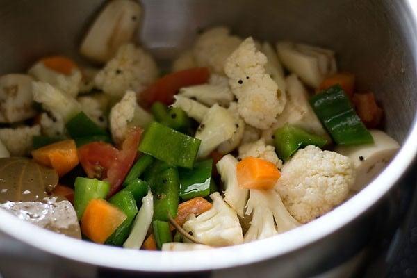 add veggies for making masala bhat